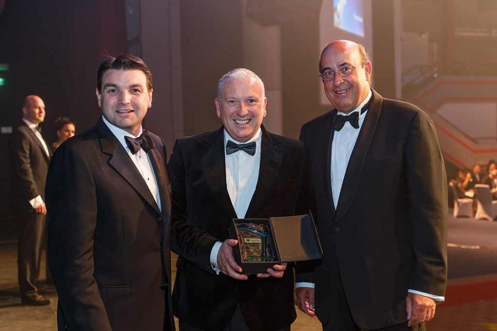TROY scoop award. MD Warren Troy receives Travelodge UK supplier of the year from CEO Peter Gowers & Chairman B Wallace